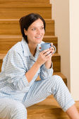 Home morning woman in pajamas drink coffee — Stock Photo