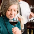 Wine bar senior woman taste wine glass — Stock Photo