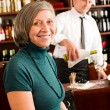 Wine bar senior woman enjoy wine glass - Stock Photo