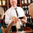 Wine bar senior couple barman pour glass — 图库照片