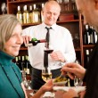 Stock Photo: Wine bar senior couple barman pour glass