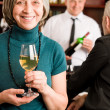 Wine bar senior woman barman discussing — Stock Photo