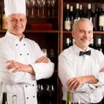 Chef cook and waiter restaurant wine bar — Stock Photo