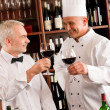 Chef cook and waiter wine tasting restaurant — Stock Photo #8529675