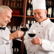 Chef cook and waiter wine tasting restaurant — Stock Photo