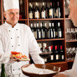 Chef cook with tapas on tray restaurant — Stock Photo