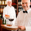 Chef cook with tapas on tray restaurant — Stock Photo #8529686