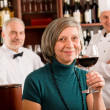 Restaurant manager taste glass red wine bar — ストック写真