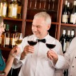 Restaurant manager posing with professional staff — Stock Photo
