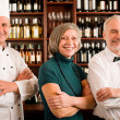 Foto Stock: Restaurant manager posing with professional staff