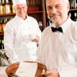 Chef cook drink coffee waiter tray restaurant — Stock Photo