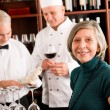 Restaurant manager with staff at wine bar — ストック写真