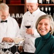 Restaurant manager with staff at wine bar — Stok fotoğraf