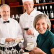 Restaurant smiling manager with staff wine bar - Foto de Stock  