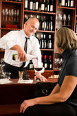 Wine bar waiter serving senior woman glass — Stock Photo