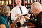 Wine bar senior couple barman pour glass — Stock Photo