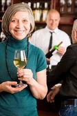 Wine bar senior woman barman discussing — Stock Photo