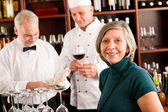 Restaurant manager with staff at wine bar — Stock Photo