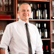 Wine bar waiter happy male in restaurant — Stock Photo #8530200