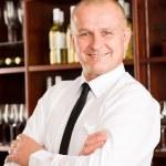 Wine bar waiter happy male in restaurant — Stock Photo