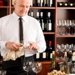 Stock Photo: Wine bar waiter clean glass in restaurant