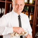 Wine bar waiter clean glass in restaurant — Stock Photo