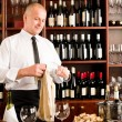 Wine bar waiter clean glass in restaurant - Stock Photo