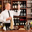 Stock Photo: Wine bar waiter cleglass in restaurant