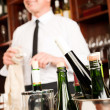 Stock Photo: Wine bar bottles waiter in restaurant