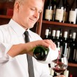 Wine bar waiter pour glass in restaurant — Stock Photo #8530310