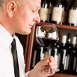 Bar waiter smell glass red wine restaurant — Stock Photo