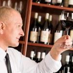 Wine bar waiter looking at glass restaurant — Stock Photo