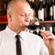 Stock Photo: Bar waiter taste glass red wine restaurant