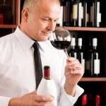 Bar waiter smell glass red wine restaurant — Stock Photo #8530334