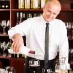 Wine bar waiter pour glass in restaurant — Stock Photo #8530342