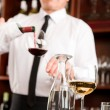 Wine bar waiter pour glass in restaurant — Стоковая фотография