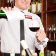 Wine bar waiter pour glass in restaurant — Stock Photo