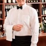 Wine bar waiter mature smiling in restaurant — Stock Photo #8530352