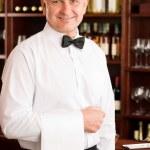 Wine bar waiter mature smiling in restaurant — Stock Photo #8530355