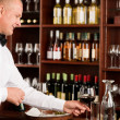 Stock Photo: Wine bar waiter mature serve glass restaurant