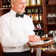 Wine bar waiter mature serve glass restaurant — Stock Photo