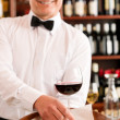 Wine bar waiter mature serve glass restaurant - Zdjęcie stockowe