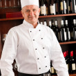 Stock Photo: Chef cook wine bar standing confident restaurant