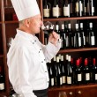 Chef cook smell wine glass in restaurant — Stock Photo