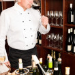 Stock Photo: Chef cook taste wine glass in restaurant