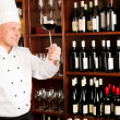 Chef cook hold wine glass in restaurant — Stock Photo