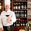 Chef cook smiling serve wine glass restaurant — Foto de stock #8530440