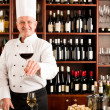 Stock Photo: Chef cook smiling serve wine glass restaurant