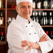 Chef cook confident professional posing restaurant — Stock Photo #8530444