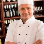 Chef cook confident professional posing restaurant — Stock Photo